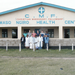 Dr. Snyder and team in front of clinic.